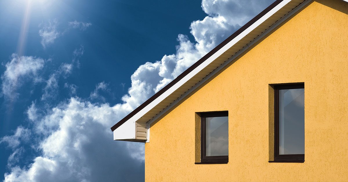 roof of yellow house under the sun